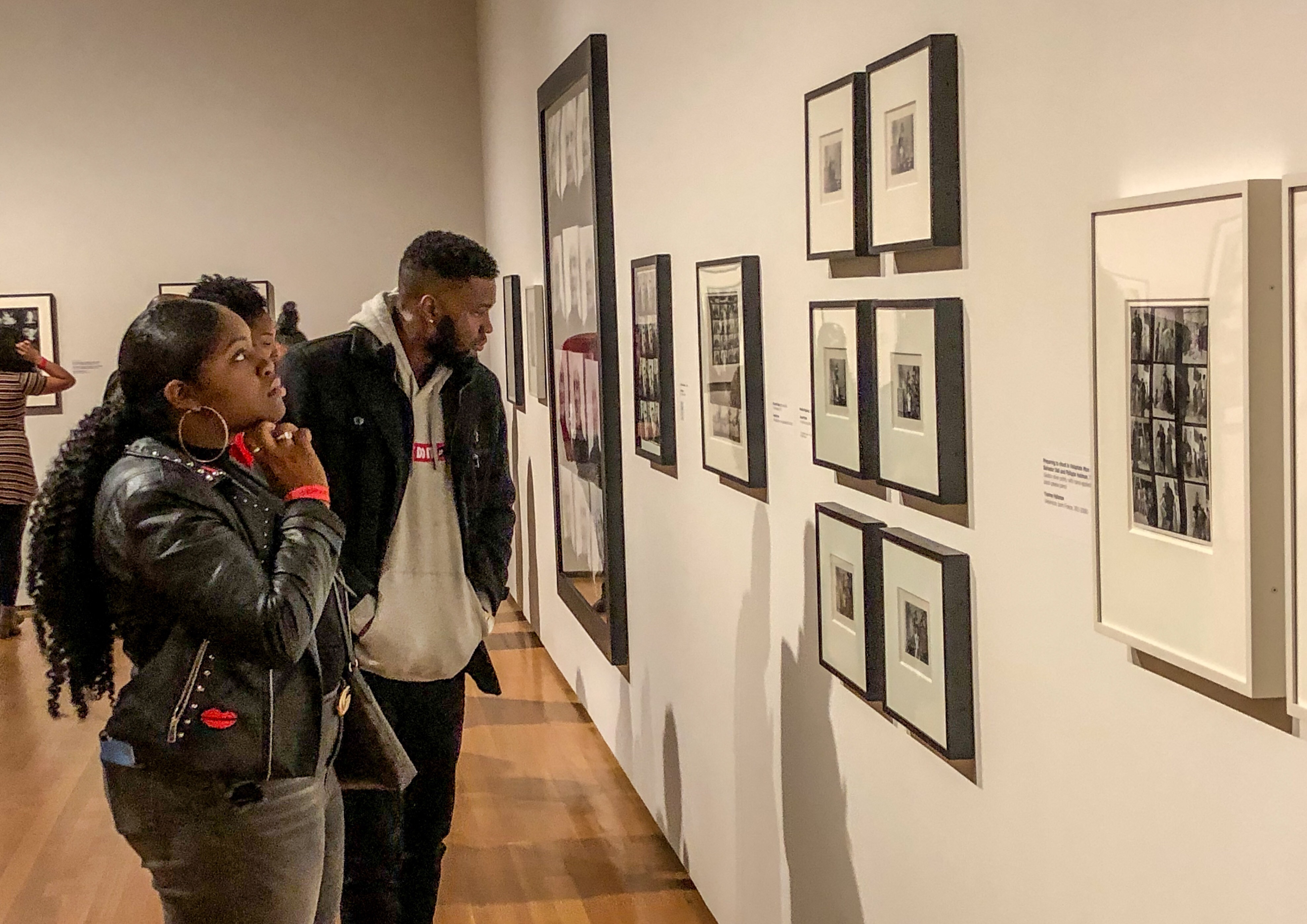 Two Cleveland Museum of Art visitors viewing the PROOF: Photography in the Era of the Contact Sheet exhibition design