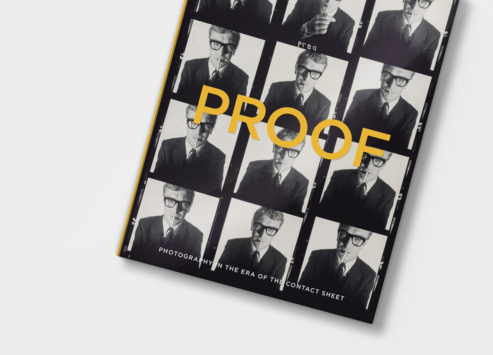 Angled view of PROOF book design with acetate cover and Micheal Caine contact sheet